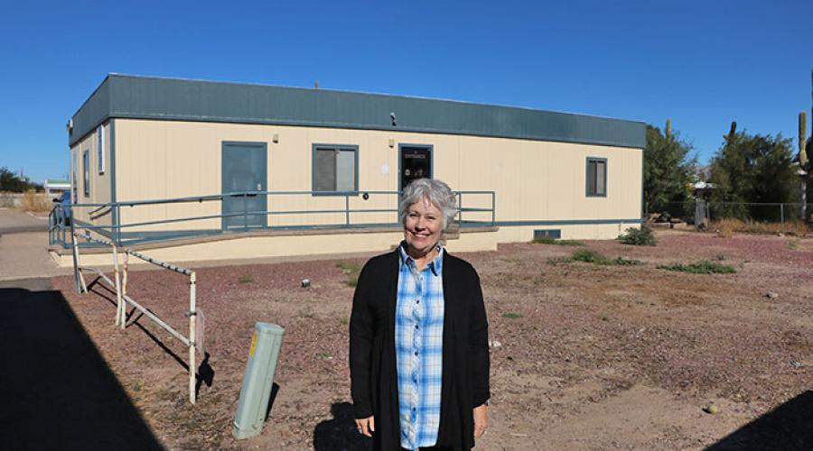 picture of woman standing in front a portable building