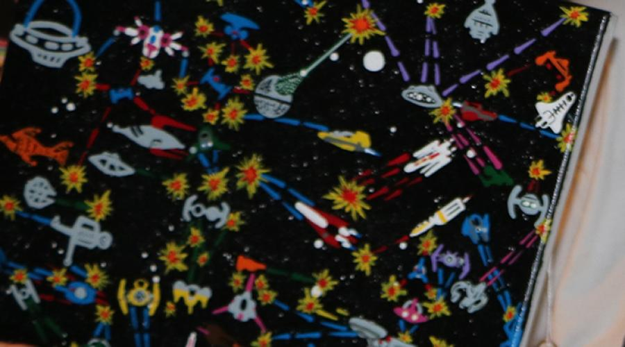 Close-up of painting featuring spaceships.