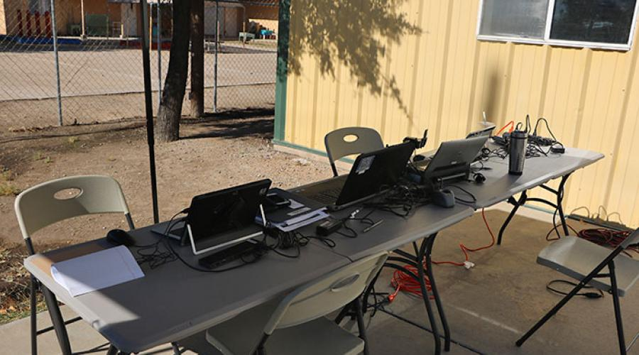 tables set up outside with laptop computers on them