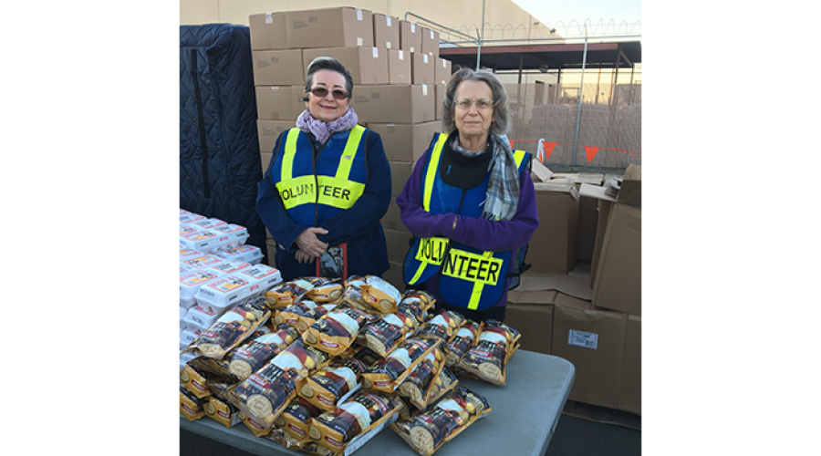 Two DES Volunteers at St. Mary's Food Bank distributing food