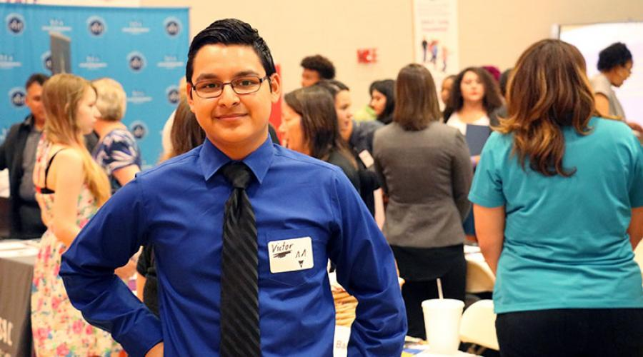Young Job Seeker poses for a photo at job fair