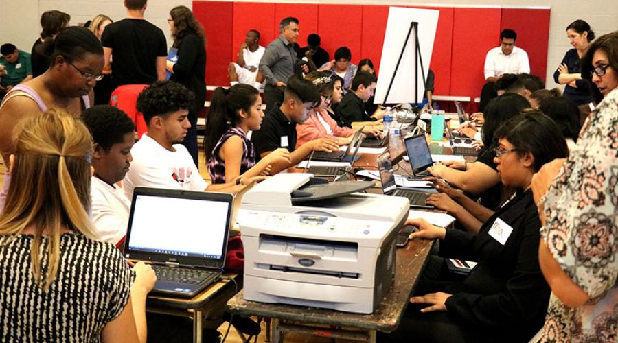 young job seekers work on computers to apply for jobs