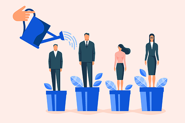 4 business professionals each stand on flower pots; a watering can pours water over them